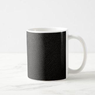 黒い革質の背景 コーヒーマグカップ