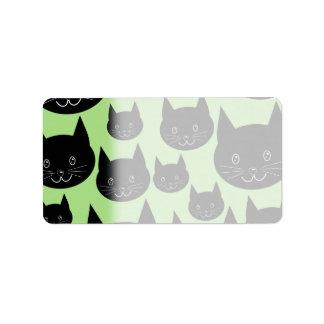 黒および緑の猫のデザイン ラベル