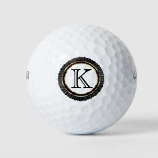 黒および金ゴールドのエレガントなモノグラム ゴルフボール