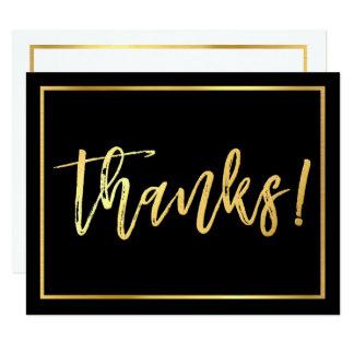 黒くするためにノートの手によって文字を入れられる金ゴールドの原稿ありがとう カード