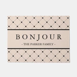 黒く点々のあるなパターンとのシックで柔らかいピンクのBonjour ドアマット