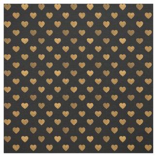 黒く、模造のな金ゴールドのグリッターの小さいハートパターン ファブリック
