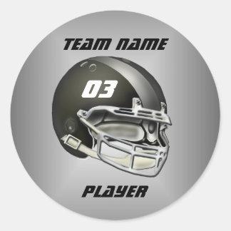 黒く、銀製のフットボール用ヘルメット 丸形シールステッカー