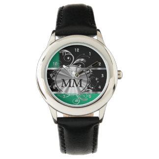黒の緑および銀製のモノグラム 腕時計
