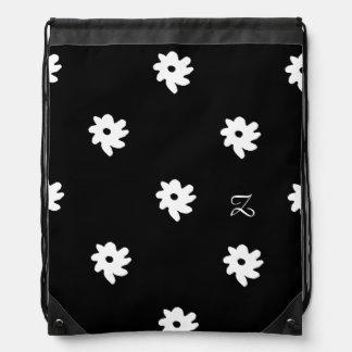 黒のZの白い花 ナップサック