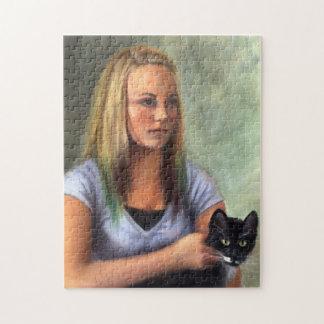 黒猫のパズルを持つ若い女の子 ジグソーパズル