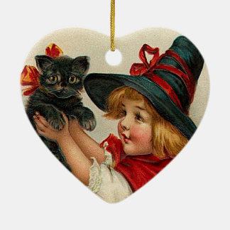 黒猫を握っているヴィンテージのハロウィンの小さい魔法使い セラミックオーナメント