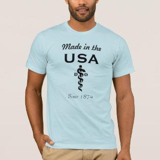 : 1874年以来の米国で作られる Tシャツ