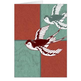 2つの飛んでいるなすずめの鳥の赤い青色のブロック カード