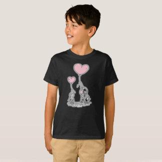 2頭のかわいい象のピンク愛は子供のTシャツを風船のようにふくらませます Tシャツ
