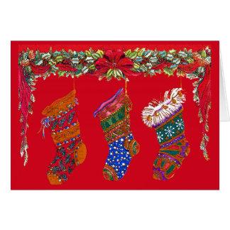 3つのカラフルなクリスマスのストッキングカード カード