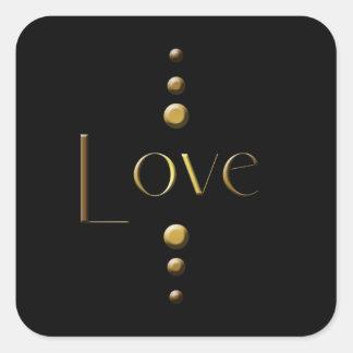 3つの点の金ゴールドのブロック愛及び黒い背景 スクエアシール