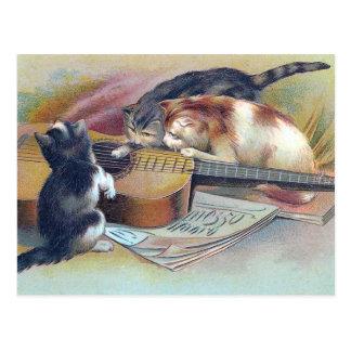 3匹の子ネコおよびギターのヴィンテージのイラストレーション ポストカード