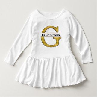 AにZのアルファベットの幼児のひだの服 ドレス