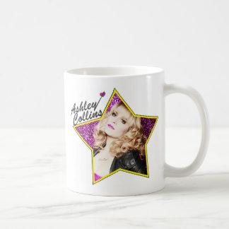 Ashley Collinsの星のマグ コーヒーマグカップ
