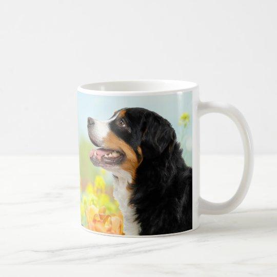 Bernese Mountain dog in the flower garden コーヒーマグカップ