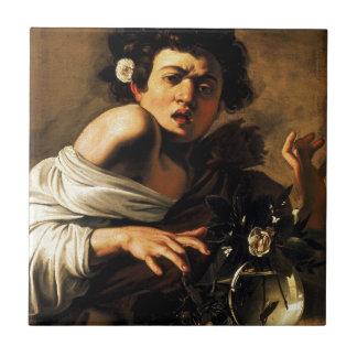 Caravaggioのトカゲの男の子 タイル