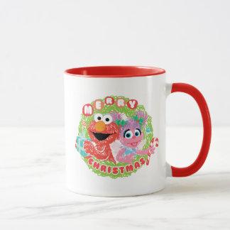 ElmoおよびAbbyの走り書き マグカップ