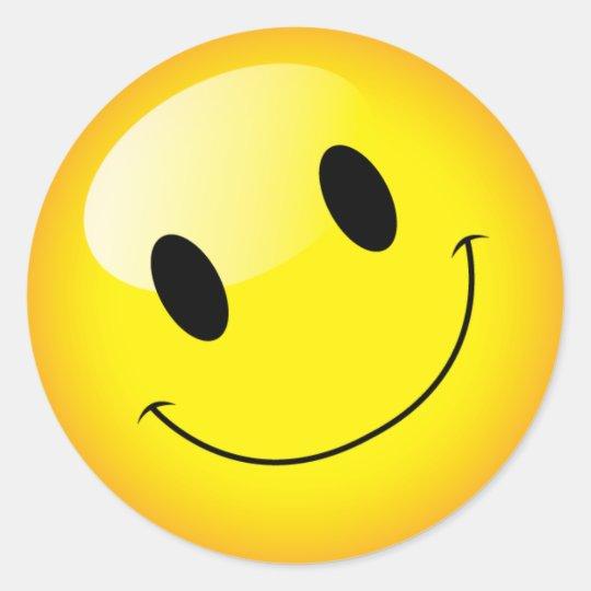 emojiの黄色いパーティーの幸せな顔の記号を元気づけて下さい ラウンド
