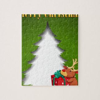 gを抱き締めているトナカイが付いている緑のクリスマスカード ジグソーパズル