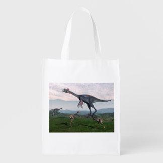 Gigantoraptorおよび小さいmononykusの恐竜- 3D r エコバッグ