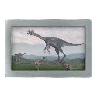 Gigantoraptorおよび小さいmononykusの恐竜- 3D r 長方形ベルトバックル