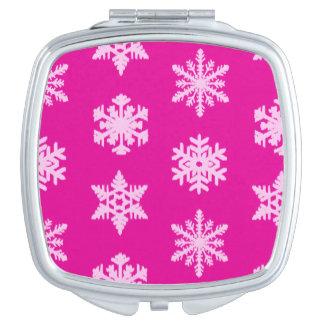 Ikatの雪片-明るい赤紫色および氷のピンク