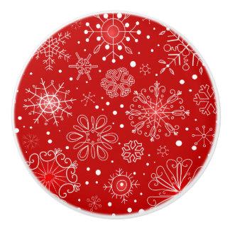 KRWのレースのようで白い雪片のクリスマスの赤いノブの引き セラミックノブ