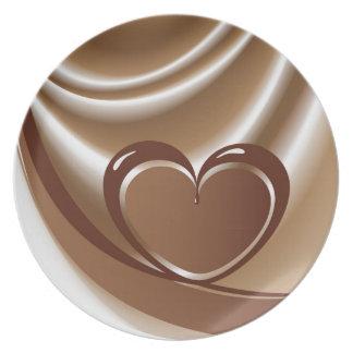 mの背景のテープからのチョコレートハート プレート