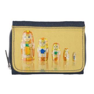 Matryoshkaのロシアのな人形のオレンジの財布