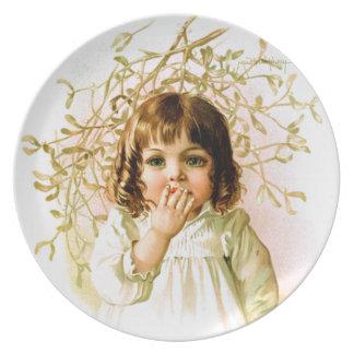 Maud Humphrey: ヤドリギの下の冬の女の子 プレート