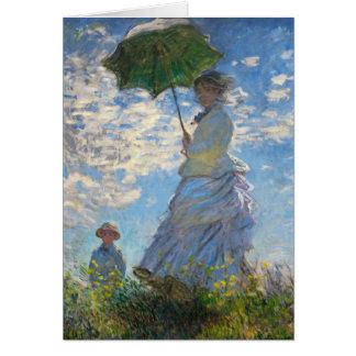 Monetパラソルを持つ遊歩道の女性 カード
