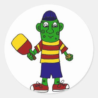 Pickleballのかいおよび球を握るおもしろいなピクルス ラウンドシール