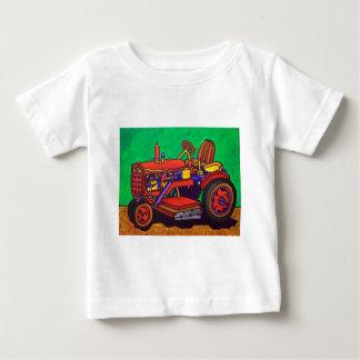 Piliero著幸せなトラクター ベビーTシャツ