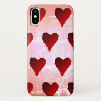 Red hearts on destroyed pink background iPhone x ケース