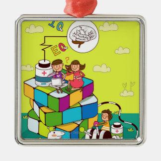 Rubikの立方体のパズルに坐っている女の子を持つ男の子 メタルオーナメント