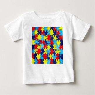 Shirleyテイラー著自閉症の認識度パズル ベビーTシャツ