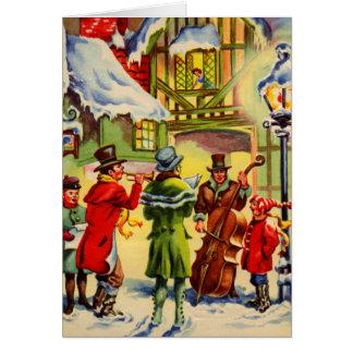 Snowyの夕べの歌うクリスマスのキャロル グリーティングカード
