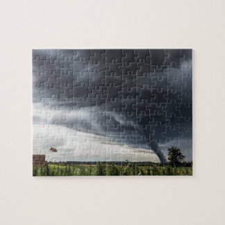Storm tornado or twister lifing hay in bad weather