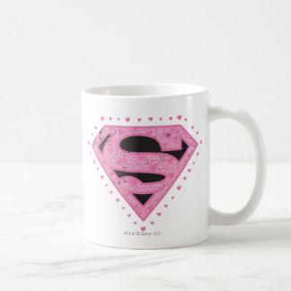 Supergirlの動揺してなロゴの黒およびピンク コーヒーマグカップ