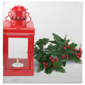 tealightのヒイラギの小枝および果実が付いている赤いランタン プリントナプキン