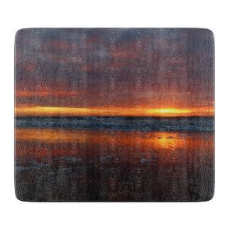 Texelのオランダのオレンジ日没のビーチの島 カッティングボード