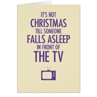 TVのクリスマスカードの前に眠った落下 グリーティングカード