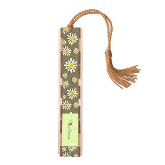 U一突き色のお洒落な野生の花のデイジーは振りかけます クルミ ブックマーク