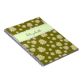 U一突き色のお洒落な野生の花のデイジーは振りかけます ノートブック